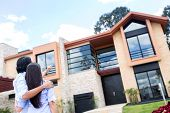 stock photo of real-estate-team  - Couple looking at a beautiful house to buy - JPG