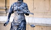 pic of scales justice  - An street sculpture like a justice symbol - JPG