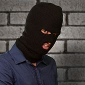 Burglar in face mask on wallpaper