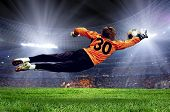 stock photo of playground  - Football goalman on the stadium field - JPG