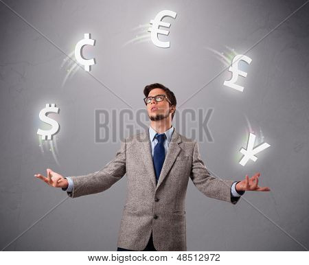 Attractie young man standing and juggling with currency icons