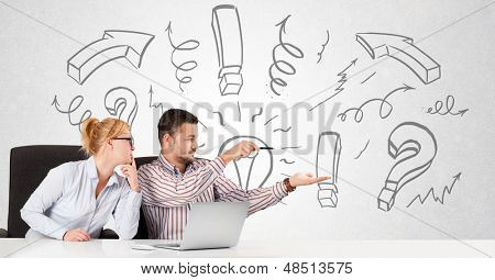 Young businessman and businesswoman brainstorming with drawn arrows and symbols