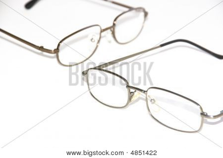 Two Pairs Of Glasses