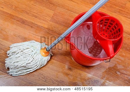 Cleaning Of Wet Floors By Mop