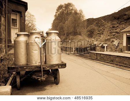 Milk churns in old railway station