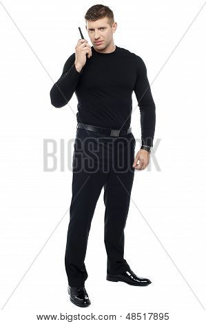 Bodyguard Communicating Via Walkie-talkie