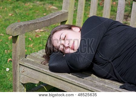 Small quiet nap on a bench, portrait of woman