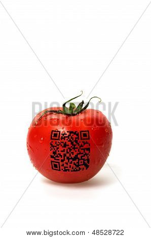 red tomato with qr code on a white background