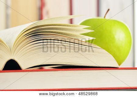 Composition With Green Apple And Books On The Table