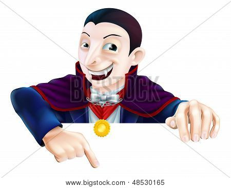 Cartoon Dracula Pointing Down