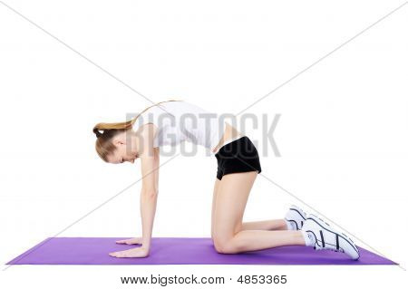 Gymnastics Of Young Girl On The Gymnastic Carpet