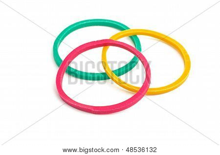 three rubber bands on a white background
