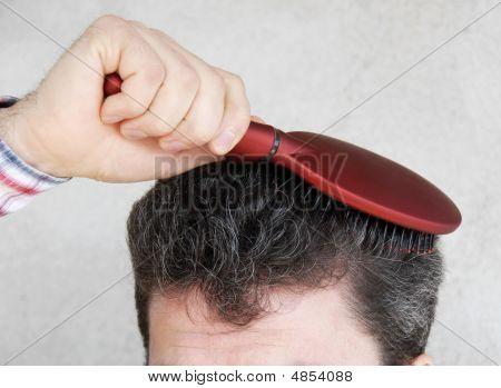 Man Brushing Hair