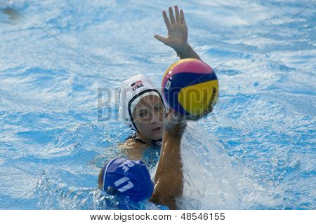 Jul 23 2009; Rome Italy; Moriah Van Norman (USA) white cap defends a ball from Stavroula Antanokou (GRE) while competing waterpolo competition at the 13th Fina World Aquatics Championships