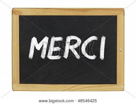 Merci (Thank you) written on a blackboard
