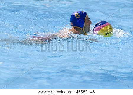 Jul 26 2009; Rome Italy; Montenegro team player Milan Ticic swims with the ball while competing in the waterpolo match between Germany and Montenegro at the 13th Fina World Aquatics Championships