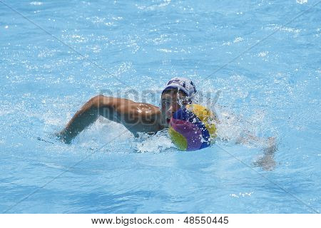 Jul 24 2009; Rome Italy; USA team player Timothy Hutten swims with the ball while competing in the preliminary round of the men's waterpolo at the 13th Fina World Aquatics Championships