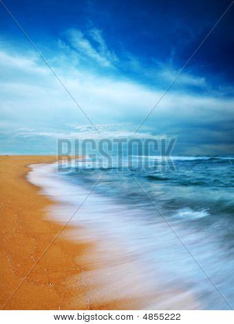 Moody Sky And Beach