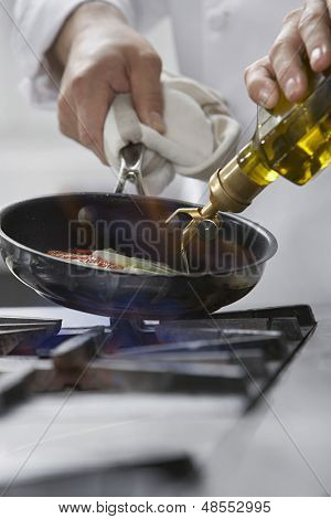Closeup of a chef cooking food in frying pan