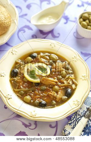 Fish solyanka with capers and olives