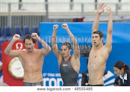 Jul 02 2009; Rome Italy; Aaron Piersol, Eric Shateau Michael Phelps celebrate winning the 4 x 100m medley final at the 13th Fina World Aquatics Championships held in The Foro Italico Swimming Complex