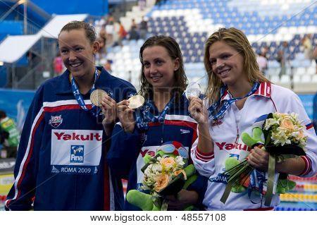Jul 28 2009; Rome Italy; Kasey Carlson (USA) bronze medal winner, left Rebecca Soni (USA) gold medal winner, centre and Yuliya Efimova (RUS) silver medal winner, right in the 100m breaststroke