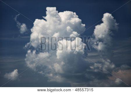 Fluffy Clouds In Dark Sky