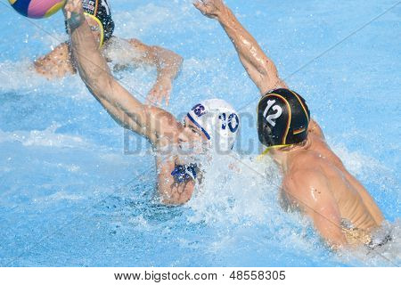 Jul 28 2009; Rome Italy; USA team player Timothy Hutten scores a goal while competing in the mens waterpolo quarterfinal match between USA and Germany at the 13th Fina World Aquatics Championships