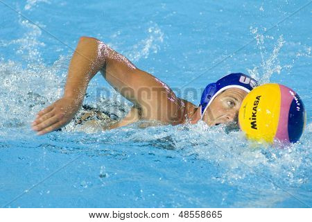 Jul 30 2009; Rome Italy; USA team player Adam Wright swims with the ball during the semi final match between USA and Spain at the 13th Fina World Aquatics Championships