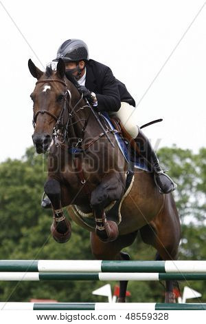 24/06/2011 HICKSTEAD ENGLAND, MURKAS MIDNIGHTLADY ridden by Nick  Charles (GBR) competing in the Hickstead Challenge at the British Jump Derby Equestrian meeting held at Hickstead West Sussex England