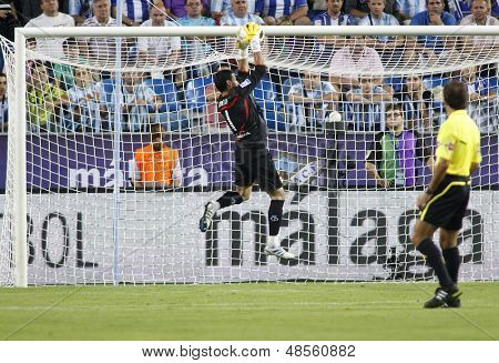 MALAGA, SPAIN. 19/09/2010. Sevilla's goalkeeper Andr�?�?�?�©s Palop (captain) makes a save during the La Liga match between CF Malaga and Sevilla, played in the La Rosaleda Stadium