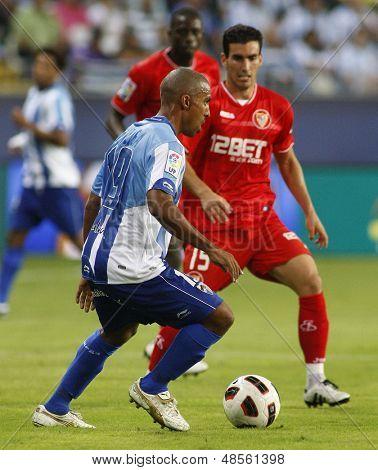 MALAGA, SPAIN. 19/09/2010. Patrick Mtiliga the Malaga defender in action during the La Liga match between CF Malaga and Sevilla, played in the La Rosaleda Stadium