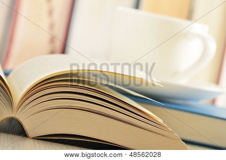 Composition With Books And Cup Of Coffee On The Table