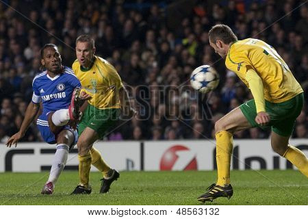 LONDON ENGLAND 23-11-2010. Chelsea's Didier Drogba takes a shot which is blocked by MSK Zilina's Jozef Pia���ek during the UEFA Champions League group stage match between Chelsea FC and MSK Zilina