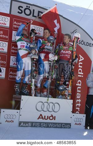 SOELDEN AUSTRIA OCT 26, Cuche waving the Swiss flag over Albrecht and Ligety the top 3 in the mens giant slalom race at the Rettenbach Glacier Soelden Austria,