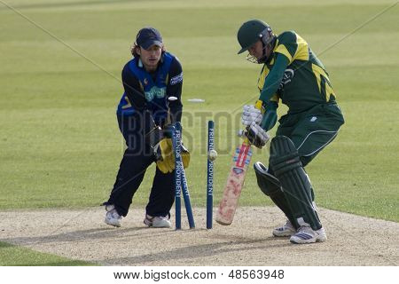 May 03 2009; Southampton Hampshire, C Crowe  is bowled by B Taylor (not pictured) as wicketkeeper T Burrows watches competing in Friends Provident trophy 1 day cricket match played at the Rose Bowl.
