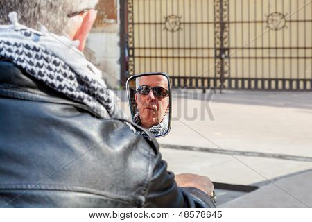 Biker Reflecting In Rear View Mirror horizontal