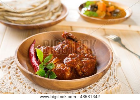 Indian curry chicken. Popular Indian dish on dining table.