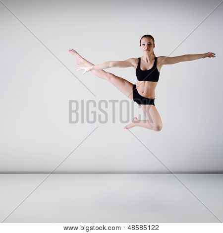 young beautiful dancer girl dancing and jumping, studio series