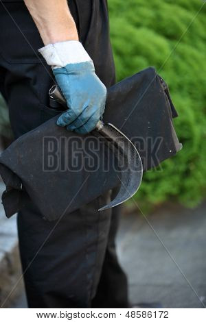 Chimney Sweep Holding A Scraping Tool