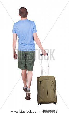 back view walking man with suitcase. brunette guy in motion. backside view person.  Rear view people collection. Isolated over white background. young man goes to side of rolling travel bag on wheels