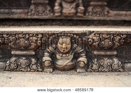 A Guardian carved on the stone steps outside a temple in Anuradhapura, Sri Lanka