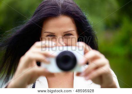 Nice woman making photo