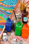 stock photo of batik  - paintbrushes and bottles with color pigments for cold batik - JPG