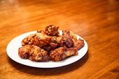 picture of mesquite  - A white plate of spicy mesquite flavored chicken wings - JPG