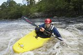 stock photo of canoe boat man  - View of a young man kayaking in river - JPG