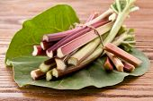 Rhubarb stalks on a wooden table.