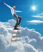 foto of pacemaker  - young man in shirt and tie pulls his arms out to the side like an airplane on top of the ladder on heaven - JPG