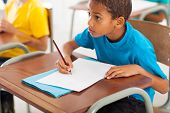 stock photo of classmates  - adorable african american primary school student studying Chinese in classroom - JPG