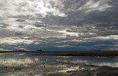 Stormy Sky Over Prairie Pond poster